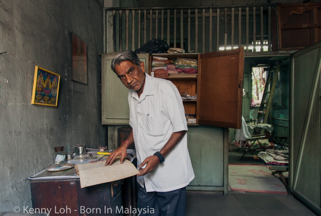 Thiru showing me the old ledgers stored on the 1st floor